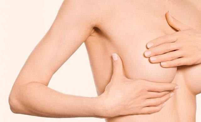 Почему набухает и болит грудь перед месячными, лечение состояния