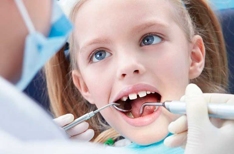 Удаление молочных зубов